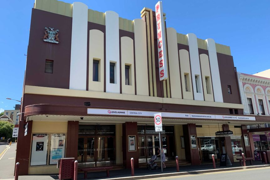 The exterior of an art-deco looking theatre.