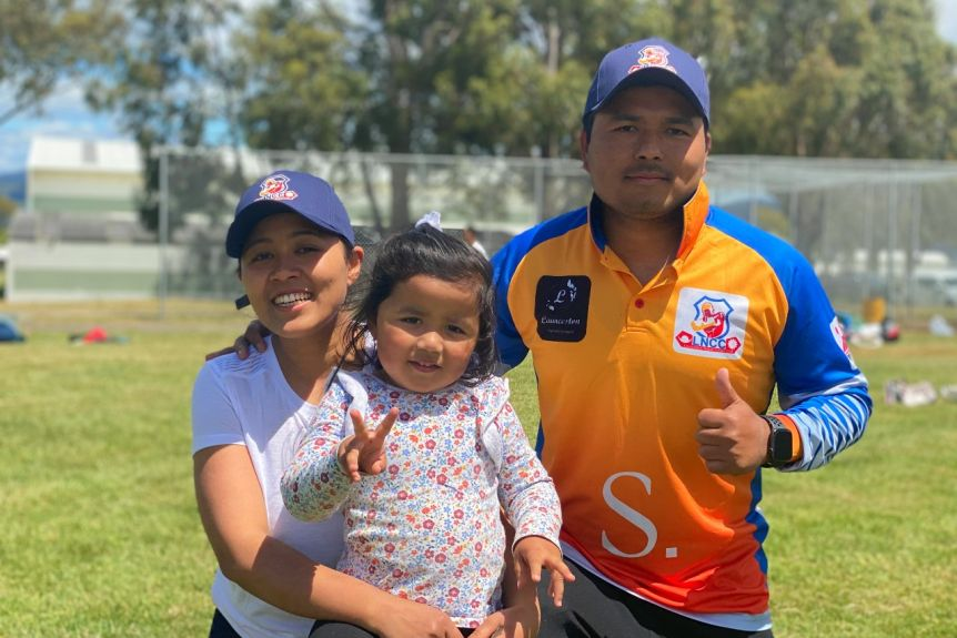 Nepalese migrants watch cricket in Launceston