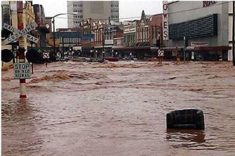 Floodwaters roar through Toowoomba's Russell Street on January 10, 2011.