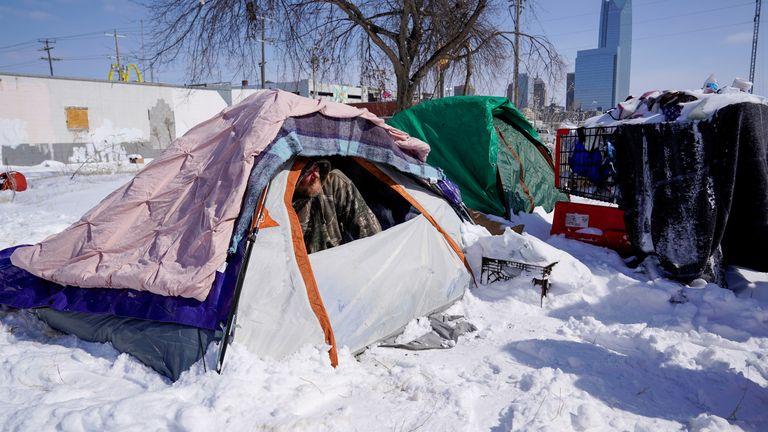 James Derrick peeks out of his tent during record breaking cold weather in Oklahoma City