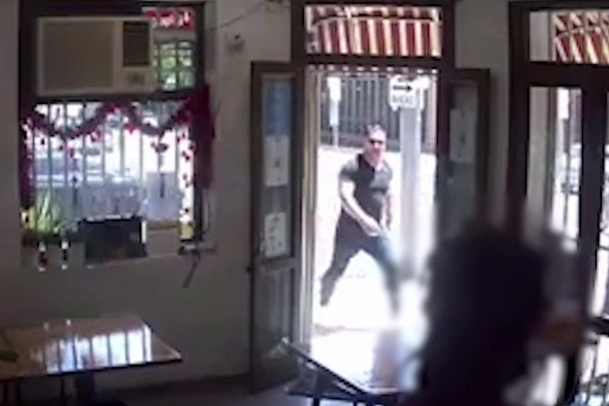 A CCTV picture of a man in a black shirt and black pants