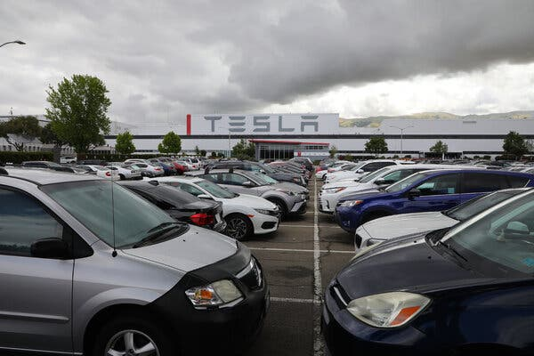 The Tesla car manufacturing plant in Fremont, Calif., remained open during the pandemic despite restrictions put in place by local officials.