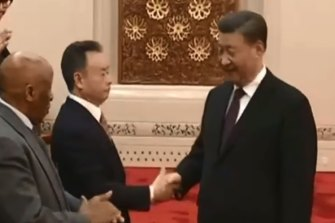 Businessman Chau Chak Wing shakes hands with Chinese President Xi Jinping during a meeting of global leaders in Beijing.