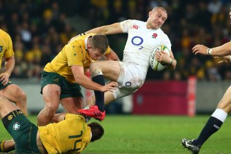 Wrapped up: England's Mike Brown is tackled at AAMI Park in 2016.